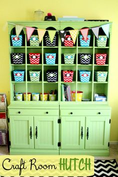 I love this craft room hutch! Pretty, lots of organized storage space and cute bunting.