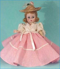 1953 Country Picnicearly strung non walking doll. Her nostalgic outfit includes a long flaring gown of sweetheart pink country gingham topped with an Edwardian style white pique jacket. The little straw hat has a flourish of a rose and plume