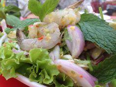 "Spicy fresh shrimp salad , in Thai called "" Phlaa Kung"""