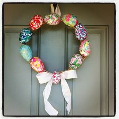 Couponing & Cooking: DIY Lilly Pulitzer Easter Egg Wreath. Made of plastic Easter eggs!