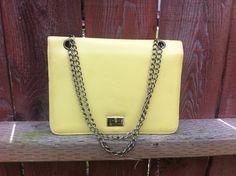 Vintage 60s Mod Yellow Envelope Purse Chain Strap Handbag Faux Leather Retro Mid Century Eames Era. $22.00, via Etsy.