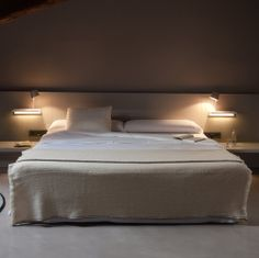 Interesting wall lights as well as the led headboard light make this ...