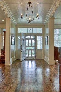 square windows at front entry. Trim work for foyer