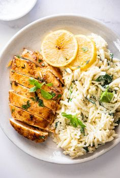 Easy lemon chicken with creamy spinach orzo - Simply Delicious Yummy Pasta Recipes, Entree Recipes, Easy Chicken Recipes, Cooking Recipes, Healthy Recipes, Yummy Food, Tasty, How To Cook Orzo, Creamy Spinach