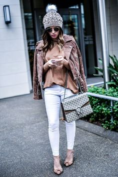 Tiffany Jais the Houston Style blogger of Flaunt and Center wearing a Blank NYC suede moto jacket with an ASOS top, white skinny jeans, and a Gucci Dionysus bag   what's trending in women's fashion
