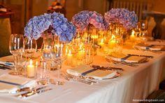 Blue hydrangeas in rectangualr vases for a blue wedding theme