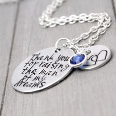"""This charming necklace is the perfect way to tell your mother in law thanks...for raising your love. Stamped with 'Thank you for raising the man of my dreams' Features & Measurements: ♥ 1"""" Aluminum Di"""
