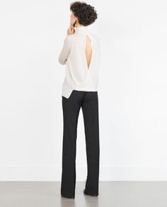 Image 1 of SWEATER WITH BACK OPENING from Zara