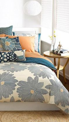 The colors and prints work for a couple's master bedroom.