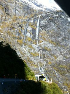 Homer Tunnel, South Island, New Zealand, You come out the bottom end of the tunnel to an amazing view of the valley and zig zag down to the valley floor as the tunnel is quite high up. Milford Track, Milford Sound, The Beautiful Country, Beautiful Places, Te Anau, New Zealand Houses, New Zealand South Island, New Zealand Travel, Mountain Range