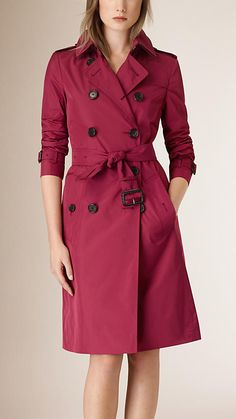 A burgundy Burberry showerproof trench coat in lightweight technical fabric. Discover the women's outerwear collection at Burberry.com