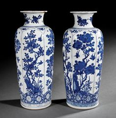 Chinese Blue and White Porcelain Rouleau Vases, probably 19th c., decorated with bird-on-branch panels, bases with artemisia leaf marks, h. 21 1/2 in.
