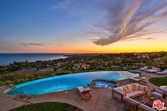 All opening to spectacular grounds that feature rolling lawns, an infinity pool, sports court, basketball court, covered patios, and outdoor terraces perfect for major entertaining.