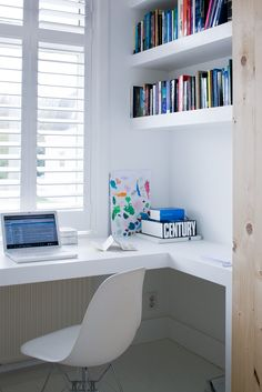 plantation shutters, clean office, nice shelving