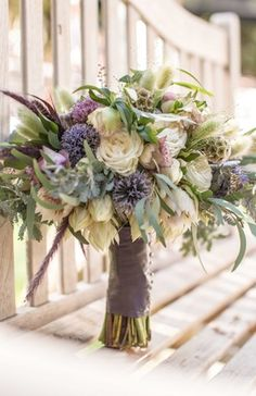 Rustic Bouquet with Purple Wildflowers   Photography: Sallee Photography. Read More: http://www.insideweddings.com/weddings/rustic-chic-lakeside-wedding-with-geometric-details-in-california/843/