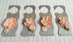 My personal DIY baby closet dividers!   -Cut out openings -Painted metallic silver -Hot glued flowers -Added sticker numbers and jewels  They look so beautiful <3