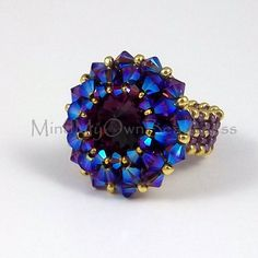 This pattern teaches you to make a super sparkly crystal ring. Instant downloadable document of step by step instruction accompanied by colored diagrams with clear thread paths. Level of difficulty: Advanced Beginner - Low Intermediate Materials used in the instruction are: Swarovski 18mm Rivoli Swarovski 4mm bicone crystal Swarvoski 3mm bicone crystal Japanese 11/o seed beads Japanese 15/o seed beads Fireline 6-lbs Beading needle #12 This pattern is for personal use only. No sharing is…