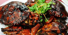"""Singaporeans love to order Black Pepper Crabs from the local """"tze char"""" stalls or seafood restaurants. Black Pepper Crab is Singapore's..."""