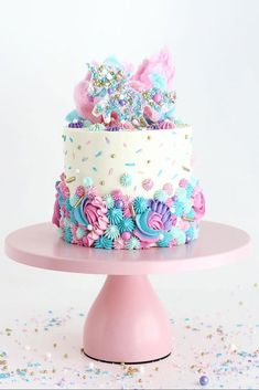 """Learn how to make this magical Unicorn Party Cake with pretty piping the """"Unicorn"""" sprinkle mix by SprinklePop a sprinkled white chocolate unicorn cake topper and cotton candy Bolo Sofia, Kreative Snacks, Cotton Candy Cakes, Unicorn Sprinkles, Cake With Sprinkles, Bolo Cake, Unicorn Cake Topper, Unicorn Cakes, Unicorn Birthday Cakes"""