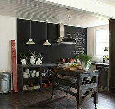 White House in Daylesford, Australia. Love this kitchen! Chalkboard wall, open cabinets and rustic island!