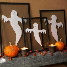 Hübsche Halloween Dekoration. Papier Geister ausschneiden und auf Glas kleben.