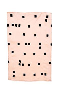 Try: Confetti SquaresThis print is bold, but in a more subtle, scattered pattern. The soft peach nicely counterbalances the black squares.