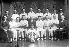 The Newport Workshops Cricket Team. The wicket keeper sits in front holding a championship shield.  Place & Date Depicted:Newport, Victoria, Australia, circa 1925  Photographer:Alma Studios, circa 1925