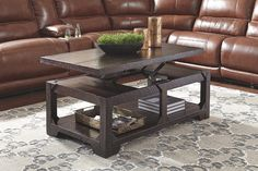 Bring rustic refinement home in a simply striking way with the Rogness lift top table. Crafted with pine wood for highly grained character, the table is treated to a dark rum-tone finish for a handsome, hearty aesthetic. Heavy distressed marks add a vintage look and feel that has so much appeal.