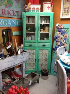 LOVE this mint colored cupboard. Two glass doors, two drawers and two solid doors at the bottom. The bottom doors have pretty map design. It would be a great addition to any room in your home. Only at #MaisonStGermain in #woodbury #CT.