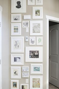 frame collage--like the shape of it, great use of space; also a good way to camouflage the doorbell chime box, thermostat, light switch and outlet....