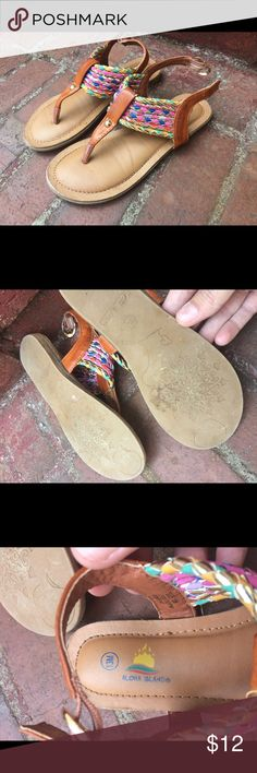 Aloha island sandals So cute! Rainbow sandals- only worn once or twice before they were outgrown. Slight wear on front as shown in pictures. Lots of wear time left in these! Aloha Island Shoes Sandals & Flip Flops