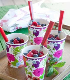 Mixed berries in pretty paper cups.