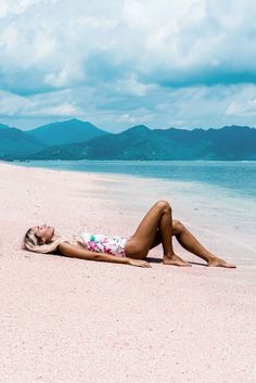 Laying on painted pink shorelines