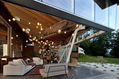 """Designed by Omer Arbel is a house for a family built on a large rural acreage outside Vancouver in the West Coast of Canada. There is a gentle slope from east to west and two masses of old growth forest defining two """"outdoor rooms"""" each with. Outdoor Rooms, Indoor Outdoor, Outdoor Living, Interior Exterior, Interior Design, Modern Interior, Wood Architecture, Vancouver Architecture, Contemporary Architecture"""
