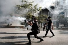 Riot police fire tear gas and rubber bullets at protesters in Istanbul's Taksim Square, on June 11, 2013