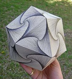 "3D Paradox Zentangle goes 3D as edges of this cuboctahedron functions as strings for Zentangle's ""paradox"" tangle. This polyhedron is great for this tangle because each facet can ""rotate"" in a different direction from each facet it touches."