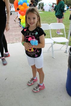 All smiles at the Purim Carnival with our balloon Twister twisting up some cute things!