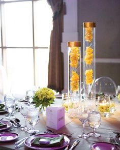 Modern Centerpiece  Tall vases topped with bangles hold chains of yellow rose petals.