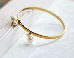 Pearl bangle - this is the listing for a chic bridal pearl bracelet with gold plated bangle adorned with Swarovski pearls. Pearls move around while