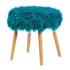 Here's a pop of color that will be right at home in your room. This cool stool features dramatic turquoise faux fur on top and simple wooden legs. It's an easy and portable way to liven up your living space.