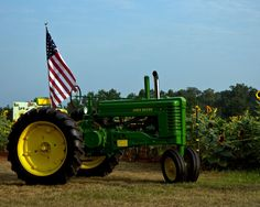 Old John Deere Tractor flying Old Glory at the Sunflower Festival 2012