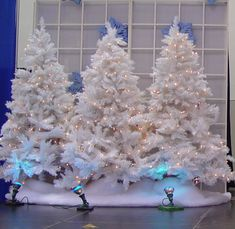 White Christmas Trees for a Winter wonderland party backdrop ~ Celebrate and Decorate