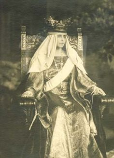 Queen Marie of Romania (1875 - 1938), with crown made from gold from Transylvania, with turquoises, moonstones and (poss) amethysts.