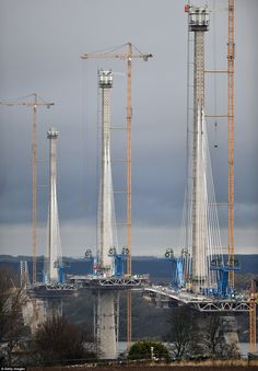 New crossing's three concrete towers stand tall - thanks to MILES of cable - as builders prepare to finish construction: The bridge will be held up by three concrete towers with cables extending from them Civil Engineering Projects, Civil Engineering Construction, Bridge Construction, Heavy Construction Equipment, Bridge Structure, Ing Civil, Scary Bridges, Cable Stayed Bridge, Amazing Nature
