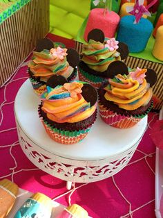 Amazing rainbow cupcakes at a Hawaiian luau Minnie Mouse birthday party! See more party ideas at CatchMyParty.com!