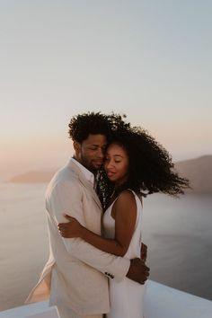 Amazing windy wedding portrait in Santorini, Greece | Image by Days Made of Love