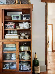 Jennifer's wooden china cabinet is a score from her favorite local design shop, Beall & Bell.