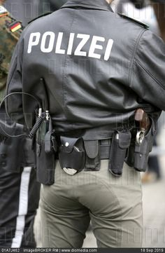 Deu germany police office with equipment belt. Millions of premium Stock photos and illustrations created by leading commercial photographers, world-famous Museums, Historical Archives and Private Collections. Image ID: Cop Uniform, Police Uniforms, Men In Uniform, Police Officer, Security Uniforms, Police Cops, Sexy Military Men, Men In Tight Pants, Hot Cops