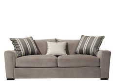 This Carlin microfiber sofa in granite will make a great addition to your contemporary living space. Its clean-lined design is comfortable yet sophisticated with wide track arms, elegant topstitching and super-soft microfiber. Three complementing accent pillows complete this sofa's stylish look.<br />
