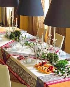 Cool Christmas Table Decorating Ideas for 2013:  I usually prefer placemats but I really like the look of 2 tablecloths.